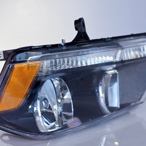 Headlamp Assy Left  Driver Side (Black Accent)